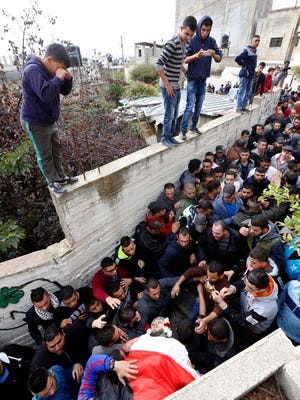 Mourners carry the body of 21-year-old Laith Manasrah during his funeral at the Qalandia refugee camp, near the west bank city of Ramallah, on Nov. 16, 2015. He was killed by Israeli armed forces during a home demolition operation.