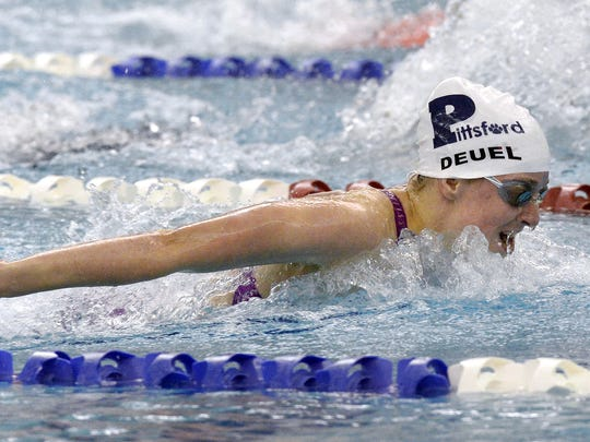 Pittsford's Megan Deuel wins the 100 yard butterfly final with a Section V record time of 55.04 during the Section V Class A Swimming & Diving Championships at the Webster Aquatic Center, Friday, Nov. 3, 2017.