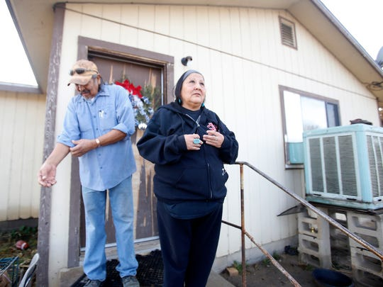 Earl and Cheryle Yazzie on Wednesday talk about the impact of the Gold King Mine spill on their farm in Shiprock.