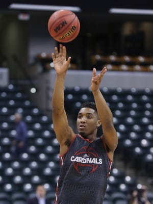 U of L's Donovan Mitchell (45) shoots a jumper during practice at the Bankers Life Fieldhouse in Indianapolis ahead of the first round of the NCAA Tournament.  
