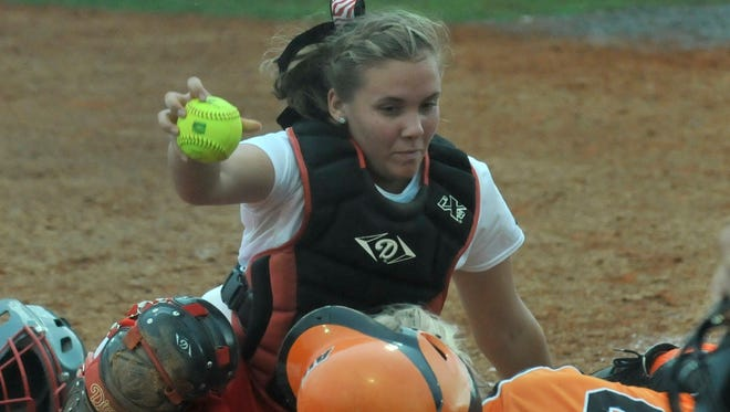 Bryan College's Becca Zimmerman (25) holds up the ball after tagging Auburn University Montgomery's Claire Wilson (00) during the NAIA Opening Round Tournament at AUM in Montgomery, Ala., on Monday, May 12, 2014.