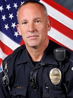 """This undated photo provided by the Rio Rancho, N.M., Police Department shows Officer Gregg """"Nigel"""" Benner, who was shot and killed during a traffic stop in Rio Rancho, N.M., in May, 2015.  Andrew Romero was convicted Friday, Sept. 23, 2016, in the shooting death of the suburban Albuquerque police officer during a chaotic traffic stop."""