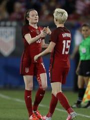 USA midfielder Rose Lavelle (16) high-fives Megan Rapinoe