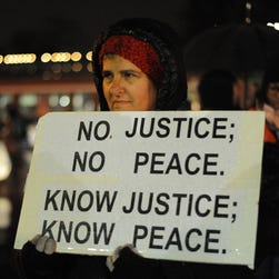 On Friday, demonstrators in Ferguson, Mo., protest the fatal shooting of of 18-year-old Michael Brown.
