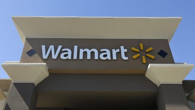 FILE - This Sept. 19, 2013, file photo, shows the sign of a Wal-Mart store in San Jose, Calif.