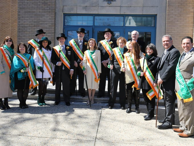 The parade committee, grand marshal and aides pose