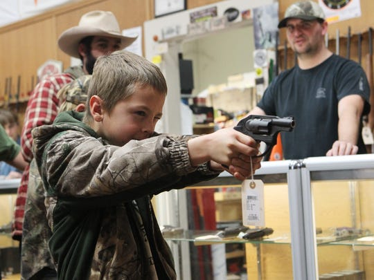 A boy takes a practice aim last January at Bastiani Arms in Redding.