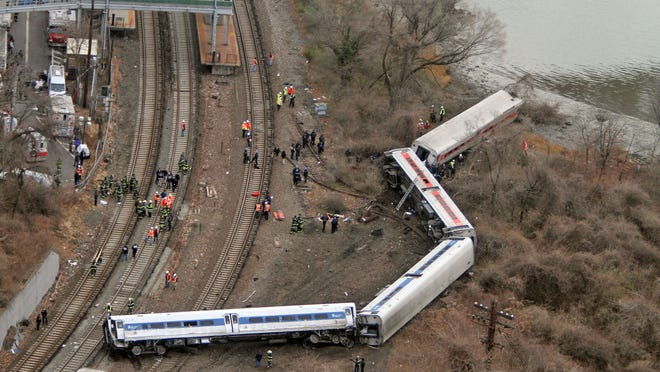 Emergency personnel work at the scene of a Metro-North train that derailed just north of the Spuyten Duyvil station in the Bronx Dec. 1, 2013. Four people were killed and dozens more were injured when the Manhattan bound train derailed shortly after 7:00 a.m. ( Seth Harrison / The Journal News )