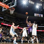 Sacramento Kings center DeMarcus Cousins, fourth from left, goes up for a basket as, from left, Denver Nuggets guard Emmanuel Mudiay, center Nikola Jokic, of Serbia, guard Gary Harris and forward Kenneth Faried defend in the first half of an NBA basketball game Tuesday, Feb. 23, 2016, in Denver. (AP Photo/David Zalubowski)