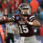 "In this Dec. 30, 2015, file photo, Mississippi State quarterback Dak Prescott (15) looks to pass against North Carolina State during the Belk Bowl NCAA college football game in Charlotte, N.C. Former Mississippi State quarterback and NFL draft prospect Prescott was arrested and charged with driving under the influence early Saturday morning, March 12, 2016. The Starkville Police Department confirmed Prescott''s arrest on Twitter late Saturday night. The post said he was arrested around 12:45 a.m. and that there is ""no further information from SPD in this incident."""