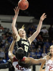 Purdue's Bridget Perry (13) loses control while defended by Oklahoma's Kaylon Williams (42) during a first round women's college basketball game in the NCAA Tournament in Lexington, Ky., Saturday, March 19, 2016. Oklahoma won 61-45. (AP Photo/James Crisp)