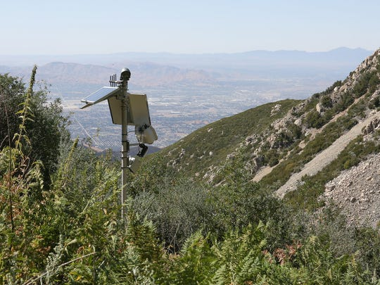 A pole mounted with a camera and other instruments sites atop one of Nestle's water tunnels in the San Bernardino National Forest.