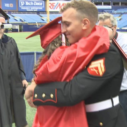 Marine Cpl.  David Van Vleet surprises his sister,