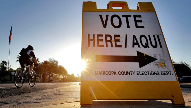 A sign directs voters to a primary election voting station in Phoenix in August. Early voting kicks off soon across the country for the November election.