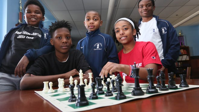 Left to right, sixth-grader Jiheed Pruden, 11, eighth-grader Eric Farrell, 13, fourth-grader Stephfan Smith, 10, seventh-grader Maddy Yates, 12 and seventh-grader Mark Coney, 13, all on the chess team at Thomas Edison Charter School. The team won the National Championship in 2014 and will compete to win again in April.
