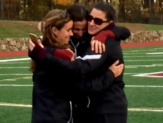 Scarsdale coach Sharon Rosenthal (l) embraces Genette