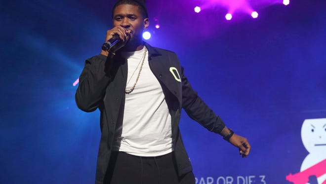 Usher performs in Dec. 10 during Winterfest 2016 at Philips Arena in Atlanta.