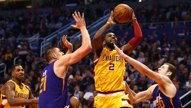 Cavaliers guard Kyrie Irving drives to the basket against the Suns at Talking Stick Resort Arena.