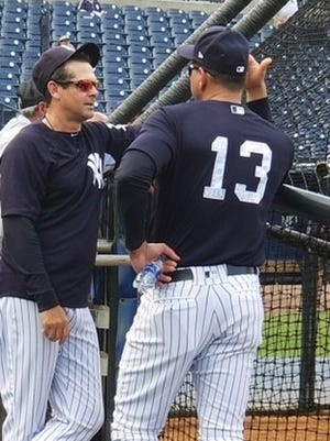 Alex Rodriguez talks to Aaron Boone at Yankees camp.