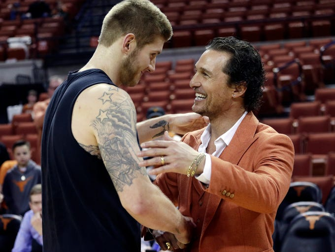 Matthew McConaughey, right, visits with Texas forward
