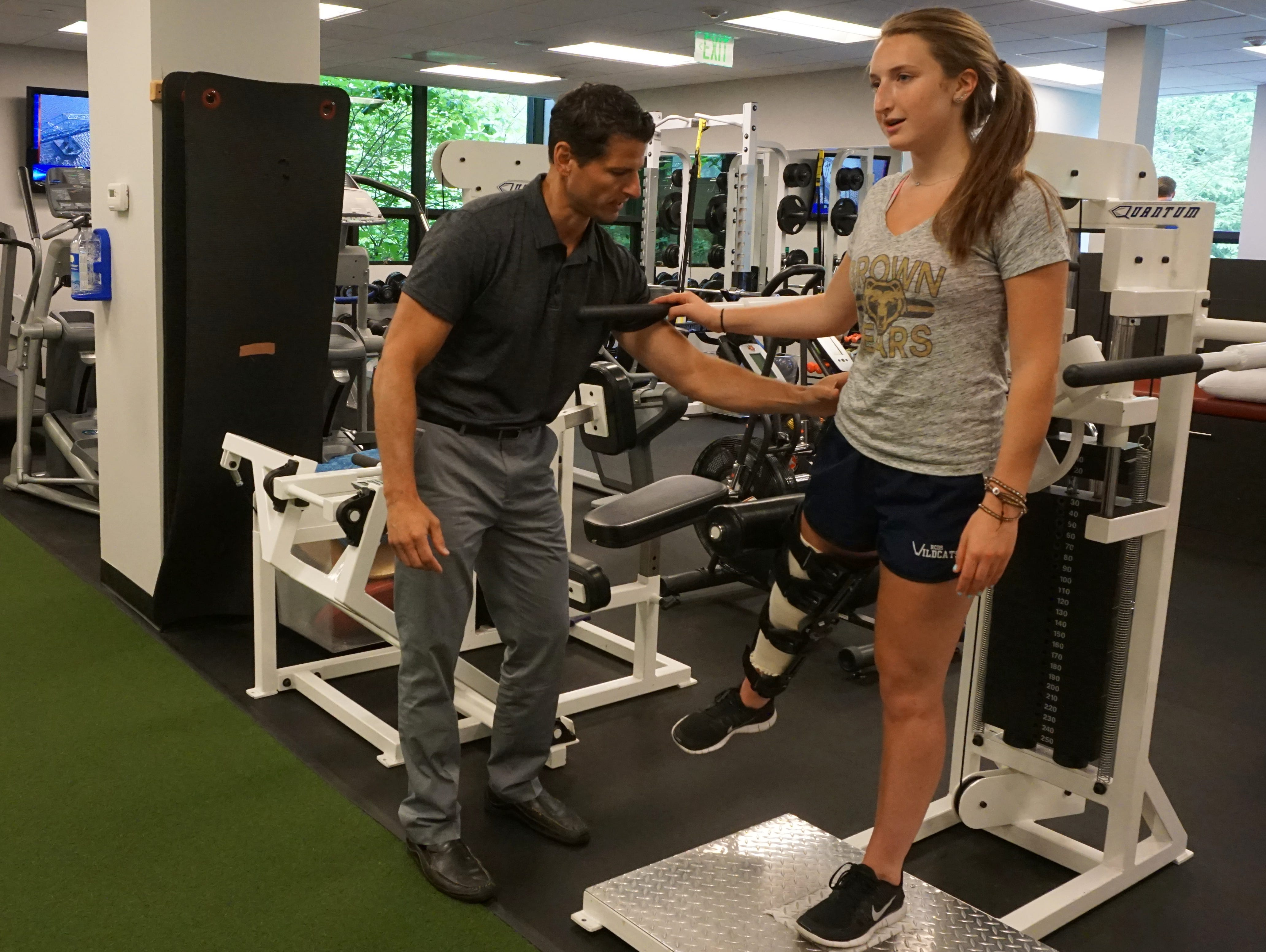 Robert Fay works with Maddy Cooper at his physical therapy practice.