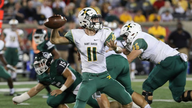 St. X's QB Jack Albers (11) passed against Trinity during their game at Papa John's Cardinal Stadium.