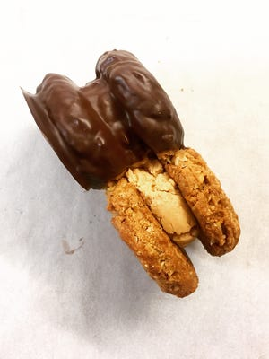 C. Adam's Bakery's Nutter Butters have a creamy peanut butter filling and a dark chocolate coating on half the cookie.