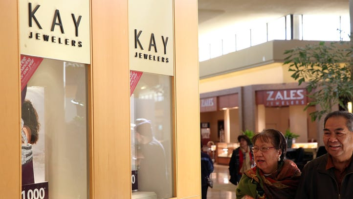 Shoppers walk by a Kay Jewelers store at the Serramonte Mall in February 2014 in Daly City, Calif.