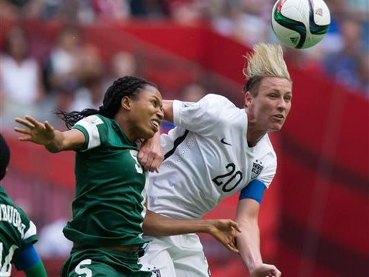 Nigeria's Onome Ebi, left, and United States' Abby Wambach vie for the ball during the second half of a FIFA Women's World Cup soccer game Tuesday, June 16, 2105, in Vancouver, British Columbia, Canada.