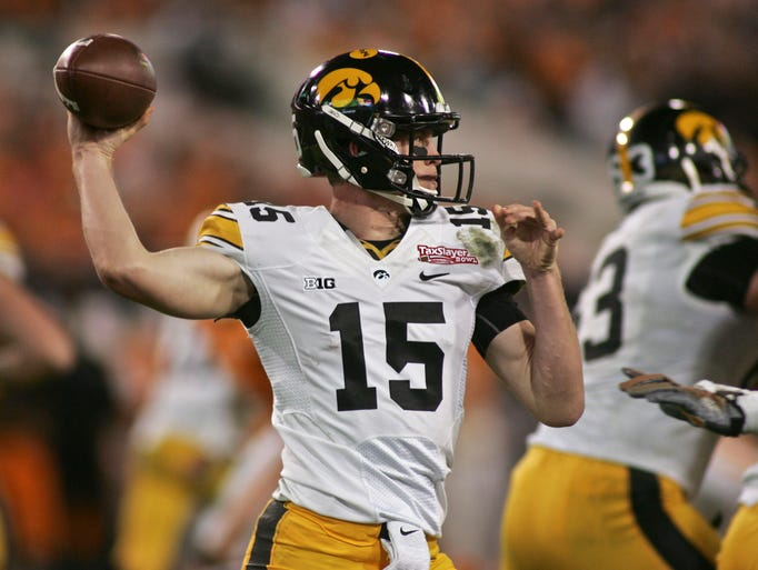 Iowa quarterback Jake Rudock (15) throws in the fourth