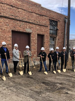 Members of OCCK transportation, Hutton Construction and DMA Architects, break ground for the expansion of the OCCK transportation facility.