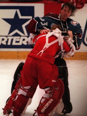 Patrick Roy, right, and Chris Osgood duke it out April 1, 1998, at Joe Louis Arena.