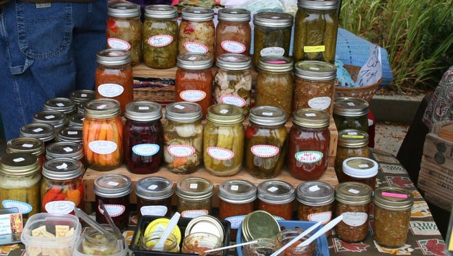:  A plethora of pickles at a New England Farmers' Market: A hundred years of family traditions in one display.