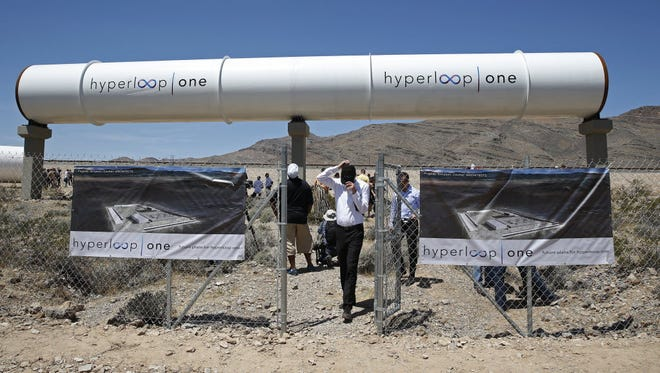 People tour the site after a test of a Hyperloop One propulsion system in North Las Vegas, Nev.