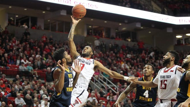 Texas Tech Red Raiders guard CJ Williamson (3) shoots over West Virginia Mountaineers guard Tarik Phillip (12) during a game at United Supermarkets Arena in January.