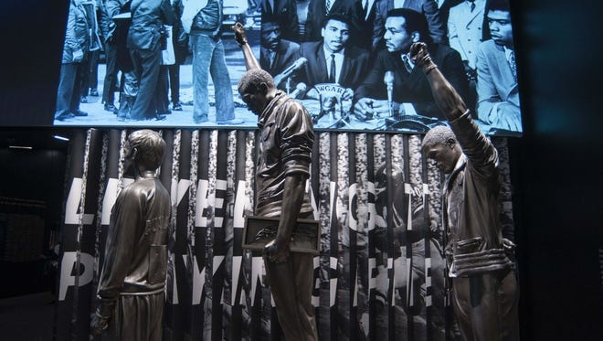 Statue of athletes making the Black Power salute at 1968 Olympics, National Museum of African American History and Culture, Washington, DC, Sept. 14, 2016.