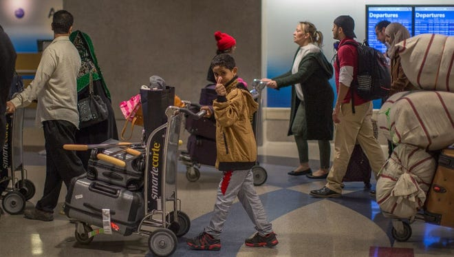 Hezam Abdallah, 11, of Yemen, was among those stranded in Djibouti when President Trump ordered his travel ban. He is seen arriving here in Los Angeles International Airport on Feb. 8.