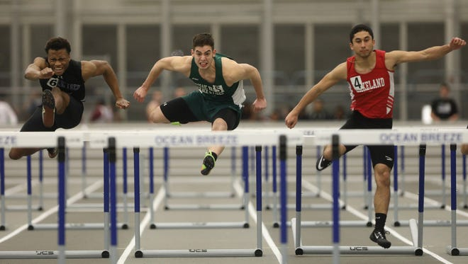Lakeland's Kyle Gonzalez, right, races against Shayne Coley of Passaic County Tech and Erick Alvarez of Passaic Valley in the 55 hurdles at this past January's Passaic County Indoor Track Championships at the Ocean Breeze Athletic Complex in Staten Island, NY.