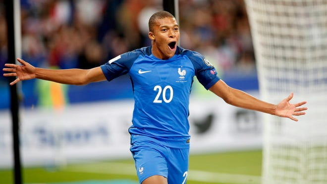 Kylian Mbappe celebrates after scoring a goal in France's 4-0 win over the Netherlands during a World Cup qualifier.