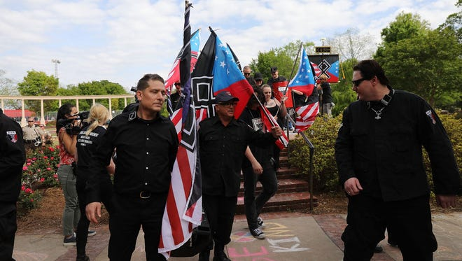 Members and supporters of the National Socialist Movement, one of the largest neo-Nazi groups in the US, hold a rally on April 21, 2018 in Newnan, Georgia.