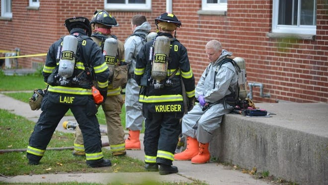 Hazmat suited firefighters at meth lab scene 1436 W. Mason St in Green Bay.
