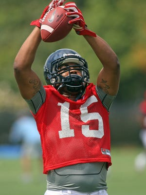 Tight end Octavious Cooley catches a pass during Ole Miss' preseason practice.