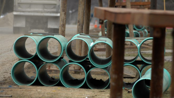 Stacks of storm sewer pipe line a Richmond street.