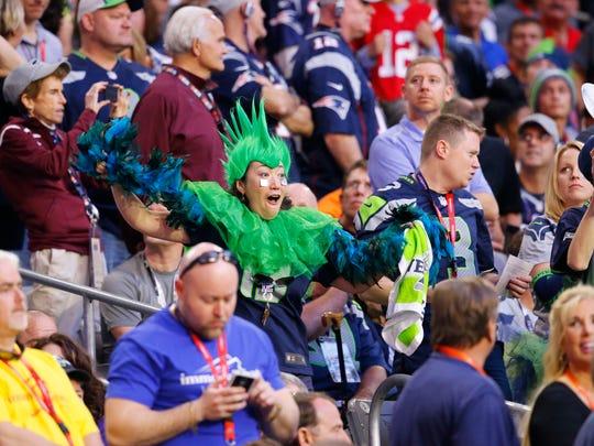 Seattle Seahawks fan celebrate after the Seahawks make