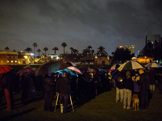 Protesters gather at Margaret T. Hance Park in Phoenix for a demonstration against the inauguration of President Donald Trump on Jan. 20, 2017.