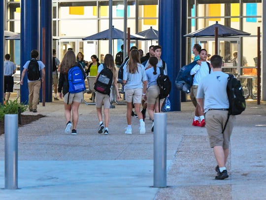 Students arrive at Southside High in Youngsville, LA