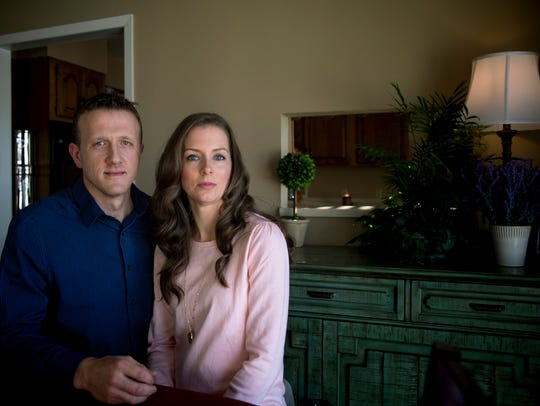 Aaron Roberts poses for a portrait with his wife, Jennifer,