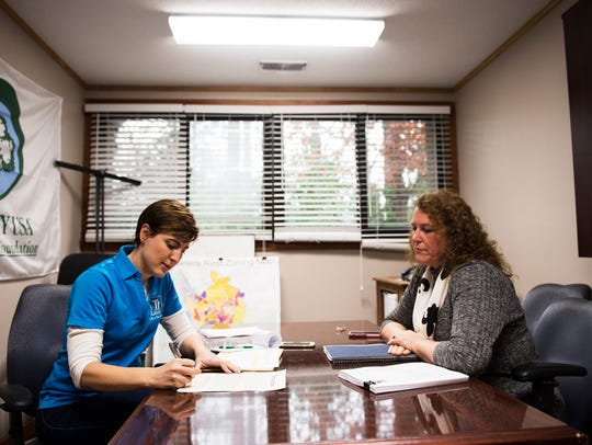 Travelers Rest mayor Brandy Amidon, left, meets with