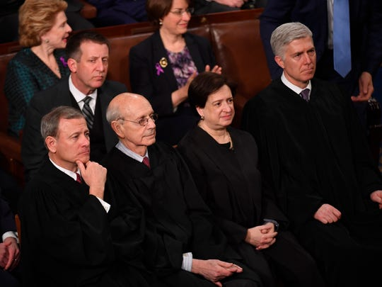 Chief Justice of the U.S. Supreme Court John Roberts,left, Associate Justice Stephen Breyer, Associate Justice Elena Kagan and Associate Justice Neil Gorsuch, right, listen as President Trump delivers the State of the Union Address.