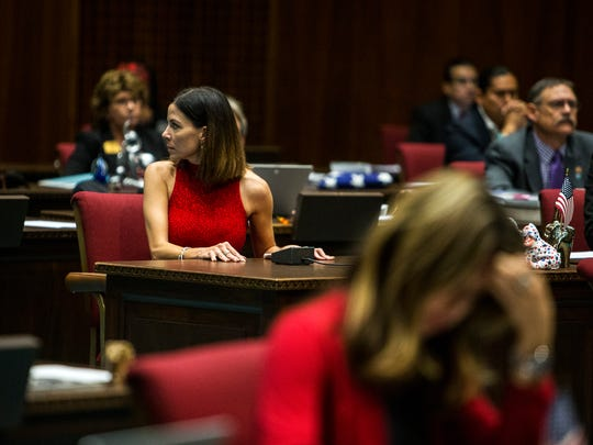 "Rep. Michelle Ugenti-Rita watches as Rep. Don Shooter leaves after he voted ""no"" during a vote on whether to remove him from office on Feb. 1, 2018 at the Arizona House of Representatives chambers in Phoenix."